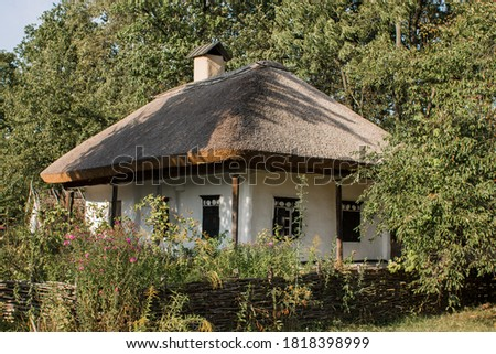 an old thatched house in the forest Photo stock ©