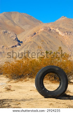 An Old Tire in the Mountain Range Landscape of Death Valley National Park, California, USA