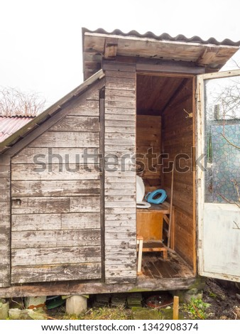 an old toilet wooden outhouse privy in the garden