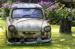 an old trabant at a garden