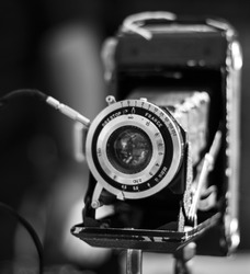 An old traditional camera with a canvas bellow