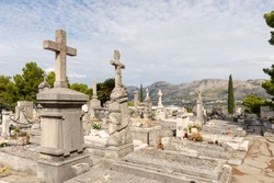 An old traditional graveyard, cemetery near the famous mausoleum in Cavtat, small town near Dubrovnik, Dalmatia Croatia. Graves are placed on a hill with view to the sea and mountains