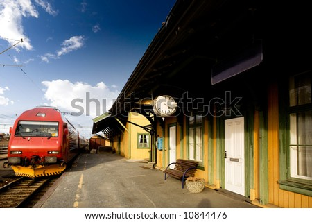An old train station against a deep blue sky