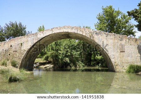 An old Turkish bridge crosses the river Megalopotamos. The Megalopotamos is one of few rivers water-leading all year round on Crete