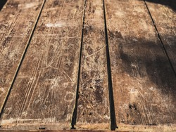 An old use table top made of wooden planks
