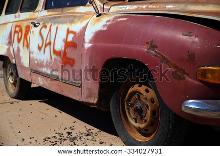 An old, vintage car being offered for sale