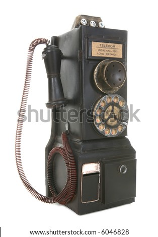 An old vintage pay phone isolated over white