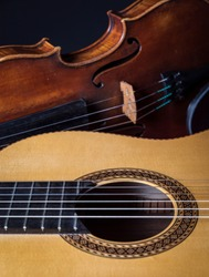 An old violin and a classical guitar