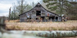 An old, weathered and dilapidated barn in rural Alabama viewed in the winter.