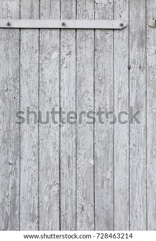An Old White Wooden Door With Hinge