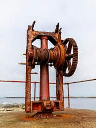 An old winch, located on the island Sletringen, in Norway