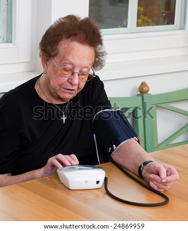 An old woman measured her blood pressure