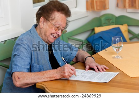 An old woman signs a contract