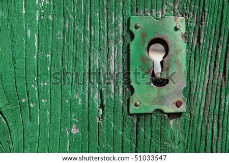 an old wood door with metal lock and keyhole - stock photo