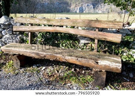 an old wooden bench in medieval ...