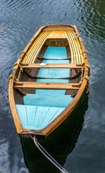 An old wooden boat with blue colour combination moored in bay age on Swedish west-coast island