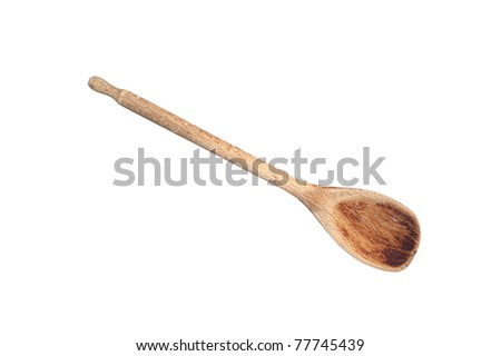 An old wooden cooking spoon isolated on white