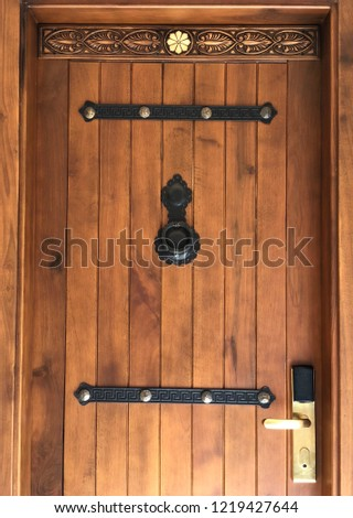 An Old Wooden Door With Keycard Access Stok fotoğraf ©