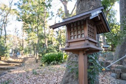 An old wooden lantern in the shrine, Yoyogi Hachiman shrine, Japan