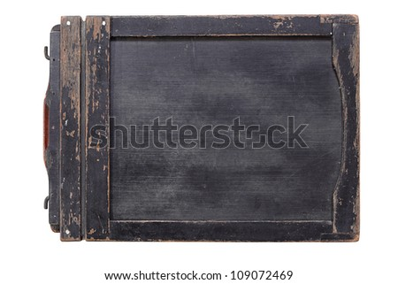 An old wooden photographic film holder isolated on white.
