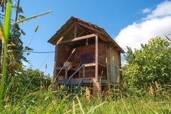 An old wooden storage hut in the field at countryside