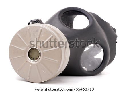 An old worn gas mask with black rubber isolated on white.  Shallow depth of field.