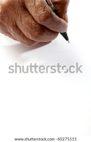 An old wrinkled hand holding a pen against a white paper background