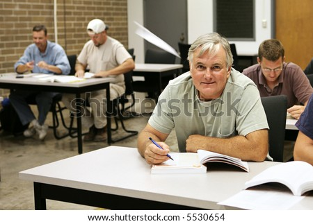 stock photo an older adult education student takes school seriously while the younger guys are goofing off 5530654 Classic Porn!