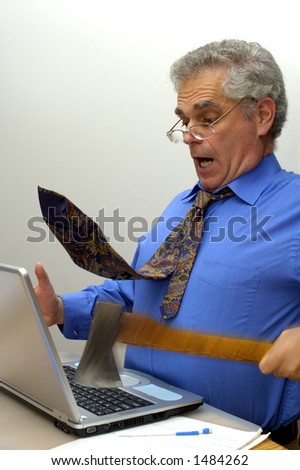 An older businessman fed up with his laptop, takes an axe to it. Motion blur on the axe and his hand. Space for text on the white background.