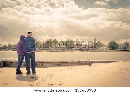an older couple on the beach...