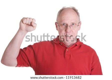 An older guy in a red sports shirt with his fist in the air in triumph or defiance