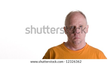 An older guy in an orange t-shirt with copy space to side