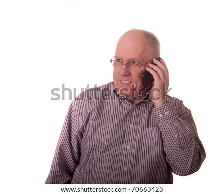 An older man talking on a smart phone and smiling