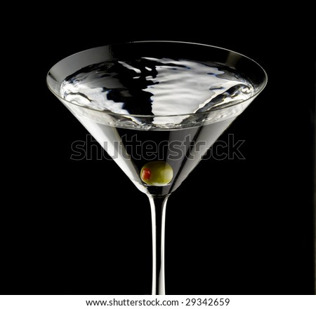 An olive in a martini glass