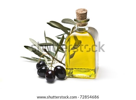 An olive oil pourer and some olives on the branch isolated on a white background. - stock photo