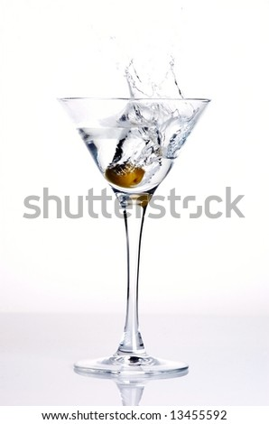 an olive splashing into a martini