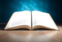 An open Bible on the table of a Catholic preacher. Word of god. Bible study. Christian faith. Appeal to God. Catholicism the concept. Catholic faith.