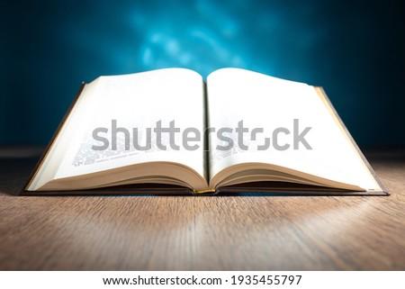 An open Bible on the table of a Catholic preacher. Word of god. Bible study. Christian faith. Appeal to God. Catholicism the concept. Catholic faith. Foto stock ©