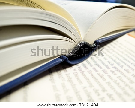 An open book on a sheet of paper
