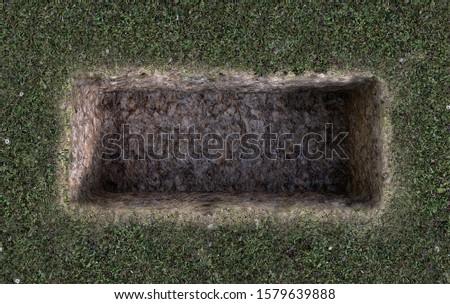 An open empty grave dug out of a field of green grass  - 3D Render Stock fotó ©