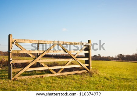 An open gate on farmland in England