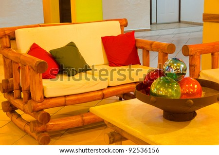 an open lobby interior of a hotel with sofa, armchairs and coffee table at night
