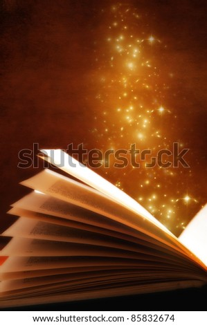 an open magic book with gold stars