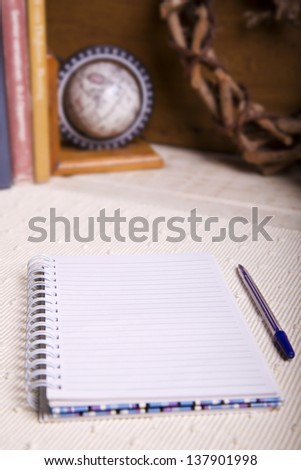 An open notebook with a pen