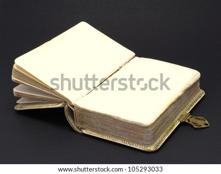 an open old history book on black background