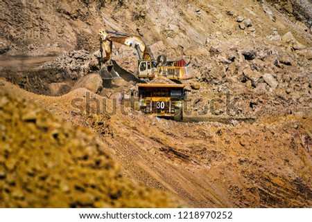 An open pit diamond mine in Botswana with heavy machinery on site.