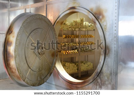 An open safe with gold and banknotes