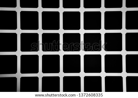 An optical illusion which creates the illusion of black dots appearing randomly. #1372608335