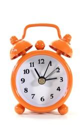 an orange clock on a white background