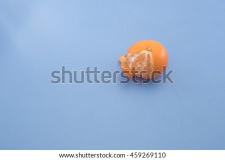 Free Photos An Orange Over A Lite Blue Background High Angle